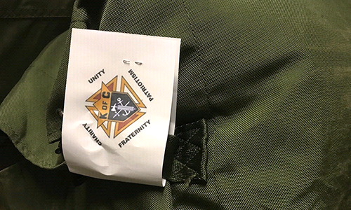 Knights Fill Duffel Bags for Homeless Vets